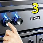 Finger pushing BBQ Grill Igniter Button